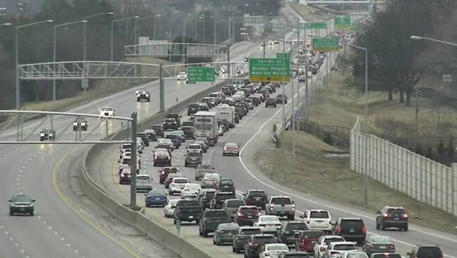 Traffic is backed up on Intestate Highway 235 in Des Moines on Monday, Jan. 9, 2017, in this image from Iowa Department of Transportation video. A crash blocked the highway's westbound lanes.