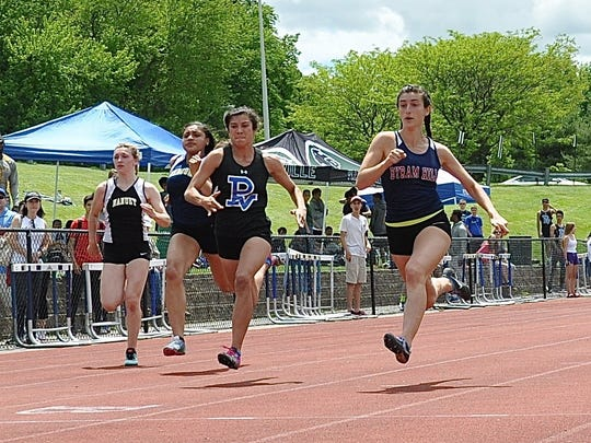 Byram Hills senior Sam Mayers (r) wins the girls Class B 100. She also won the 200..