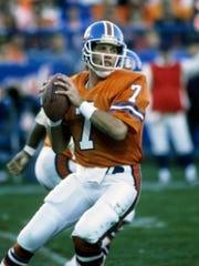 Denver Broncos quarterback John Elway (7) in action during the 1986 season at Mile High Stadium.