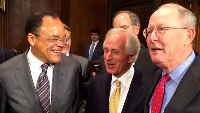 Waverly Crenshaw Jr., left, talks with U.S. Sens. Bob Corker and Lamar Alexander before a Senate Judiciary Committee hearing on his nomination to U.S. district court.