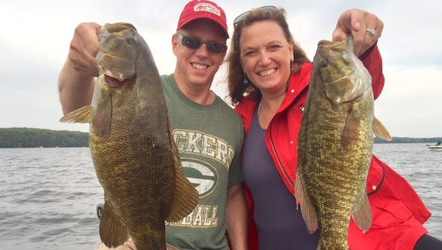 Mark and Cheri Holzer with a pair of nice smallmouth bass in the Hayward area