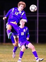 Catholic Central's Luke Goings (12) goes airborne in front of teammate Matt Turton (19).