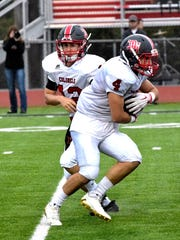 Dixie Heights Quarterback Paul Guenther makes a clean exchange to his Runningback CJ Bensman Sept. 2.