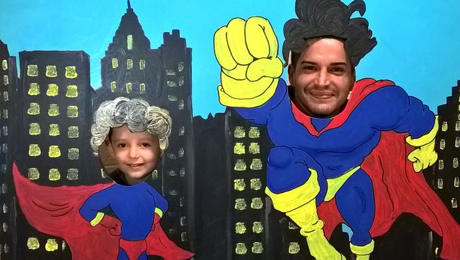 "Will Cortes and his son, Giovanni, at ""Dads Take Your Child to School Day."""