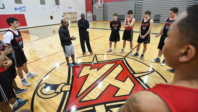 Wade Hampton boys basketball coach Reggie Choplin talks with his team during practice Monday. The Generals are 20-2 and No. 2 in the state in Class AAAAA.