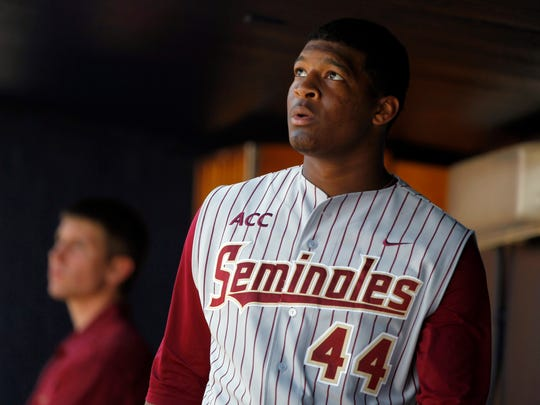 Feb 25, 2014; Tampa, FL, USA; Florida State Seminoles pitcher/outfielder Jameis Winston (44) in the dugout during the sixth inning against the New York Yankees at George M. Steinbrenner Field. Mandatory Credit: Kim Klement-USA TODAY Sports