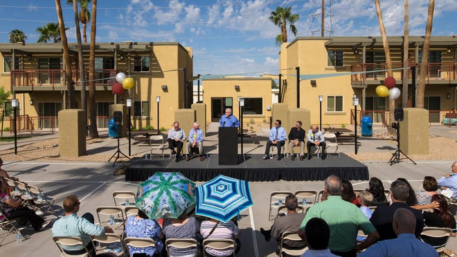 Glendale Mayor Jerry Weires speaks at the dedication of the recently renovated Ironwood Village in Glendale, on Thursday, Sept. 4, 2014. The formerly-foreclosed property is now a rental community for low and moderate income families and individuals and is fully leased.