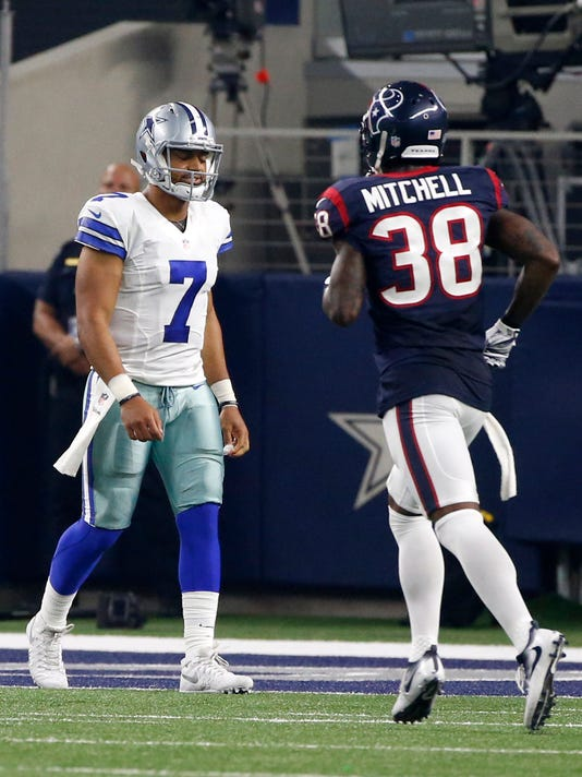 Dallas Cowboys quarterback Jameill Showers (7) walks past Houston Texans' Terrance Mitchell (38) on his way to the sideline after throwing a interception to Houston Texans' Antonio Allen who ran it back for a touchdown in the second half of a preseason NFL football game, Thursday Sept. 1, 2016, in Arlington, Texas. (AP Photo/Ron Jenkins)