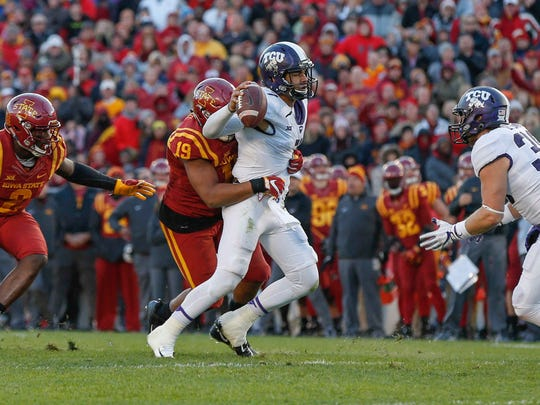 Iowa State defensive end JaQuan Bailey hits TCU quarterback Kenny Hill, Jr., on Saturday, Oct. 28, 2017, at Jack Trice Stadium in Ames.