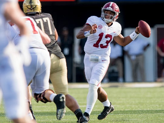 Alabama quarterback Tua Tagovailoa (13) throws against