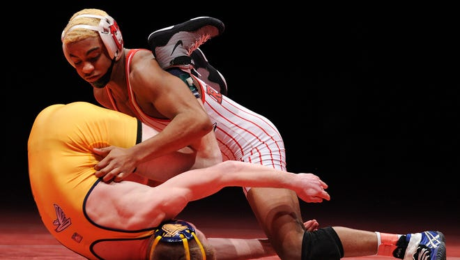 FILE -- New Palestine's Chad Red takes on Fairfield's Forrest Glogouski in the 120-pound championship during the 2014 IHSAA Wrestling State Finals inside Bankers Life Fieldhouse.