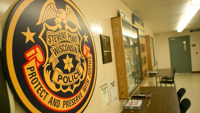The Stevens Point Police Department logo hangs in the lobby of the police department in the basement of County-City Building, Tuesday, June 9.