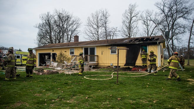 Firefighters work at the scene of a residence on Martin Road in Straban Township on March 23, 2016.