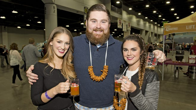 Friday evening was the kick-off for the 10th annual Cincy Beerfest at the Duke Energy Convention Center. Betsy and Dominic Rossi of Bellevue and Maddie Mullikin of Louisville.