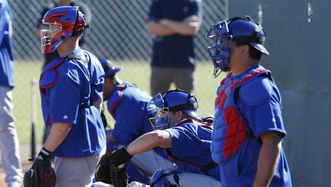 Chicago Cubs catchers work out in the bullpen during spring training 2016 in Mesa, Ariz.