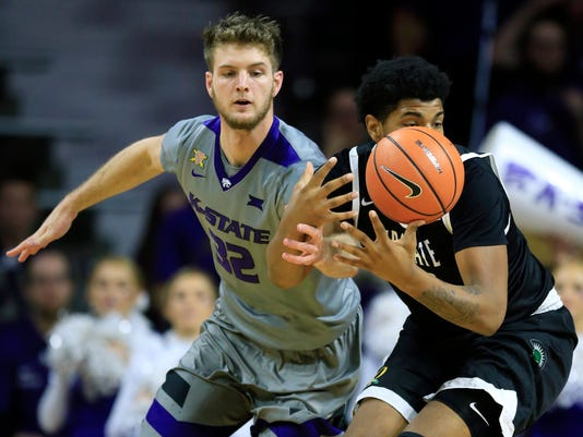 Kansas State forward Dean Wade (32) knocks the ball away from South Carolina Upstate center Isaiah Anderson, right, during the first half of an NCAA college basketball game in Manhattan, Kan., Tuesday, Dec. 5, 2017. (AP Photo/Orlin Wagner)