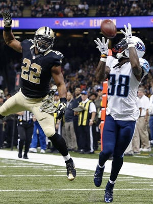 Titans cornerback B.W. Webb makes an interception of a pass intended for running back Mark Ingram during the second half against the Saints in the Superdome on Sunday.