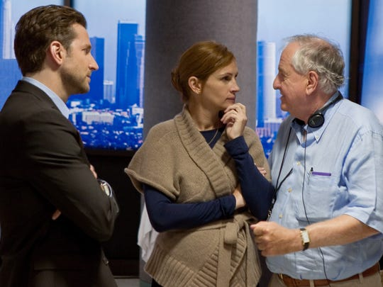 """Director Garry Marshall (right) with Bradley Cooper and Julia Roberts on the set of the 2010 ensemble comedy 'Valentine''s Day.""""'"""