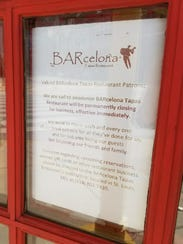 A sign on the door at BARcelona Tapas in Downtown Indianapolis