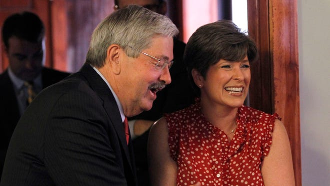 Gov. Terry Branstad and U.S. Senate candidate Joni Ernst greet one another at Smokey Row in Oskaloosa on Wednesday, June 4, 2014.