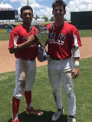 Victor Castillo and Brayden Gainey celebrate a Perfect Game Southeast Championship for Next Level Baseball.