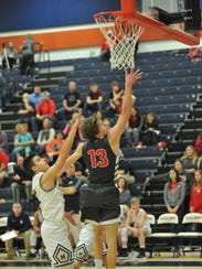 Buckeye Central's Max Loy puts up a contested layup.