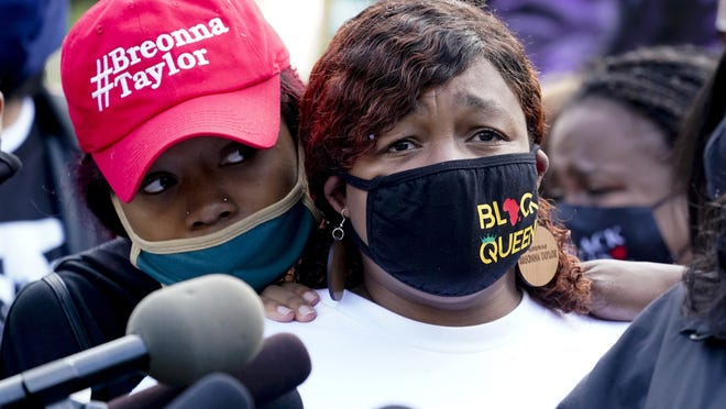 Tamika Palmer, the mother of Breonna Taylor, right, listens to a news conference Friday in Louisville, Ky.
