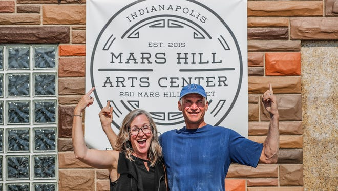 Mars Hill Art Center founders, Lisa and John Schmitz, stand in front of their building in the Mars Hill neighborhood of Indianapolis, 2811 Mars Hill St., on Thursday, July 12, 2018.