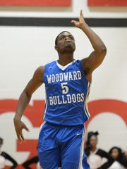 Woodward forward Terry Durham celebrates after making a 3 pointer against Hughes, Hughes High School, Friday, January, 19, 2018