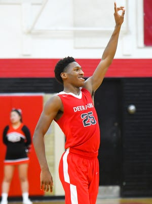Damani Mcentire of Deer Park looks at the crowd after making the game winning shot against Indian Hill at Indian Hill High School, Friday Feb. 9, 2018