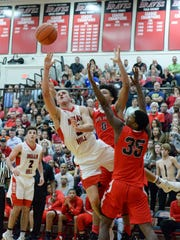 Colin Shaw of Indian Hill makes a shot at the halftime