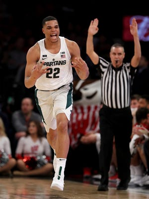 Miles Bridges celebrates his 3-point shot in the first half against Wisconsin during quarterfinals of the Big Ten tournament March 2, 2018 in New York.