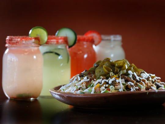 Unique homemade nachos and the variety of aguas frescas
