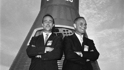 Astronauts John Glenn, right, and Scott Carpenter pose in front of a Mercury Capsule after Glenn was named to make this countrys first manned orbital flight, Nov. 29, 1961, Cape Canaveral, Fla. Carpenter was chosen as his backup pilot.