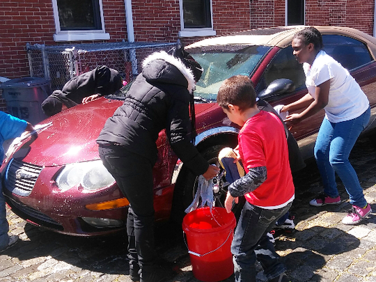 For months about a dozen Wilmington children have been washing cars, holding bake sales and raffling tickets to help pay for a trip to Disney World this summer.