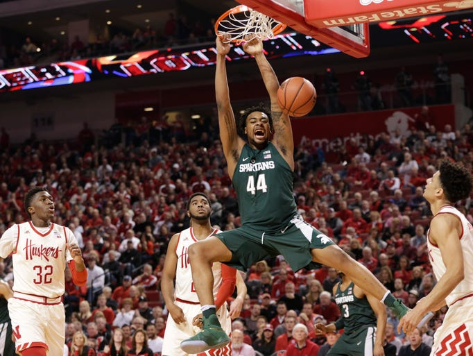 Michigan State's Nick Ward (44) dunks over Nebraska's