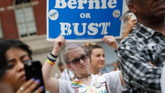 A supporter of Sen. Bernie Sanders, I-Vt., holds a
