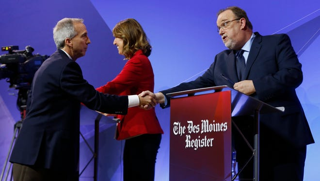 Democratic candidates Eddie Mauro shakes hands with Pete D'Alessandro Thursday, May 31, 2018, during the 3rd Congressional District debate hosted by the Register and KCCI at the State Historical Museum of Iowa in Des Moines.
