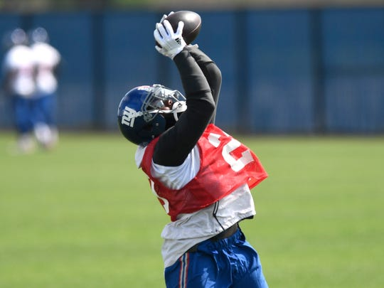 New York Giants safety Landon Collins (21) makes a catch during OTA's in East Rutherford, NJ on May 29, 2018. Collins' participation in practice was limited after undergoing surgery on his right arm.