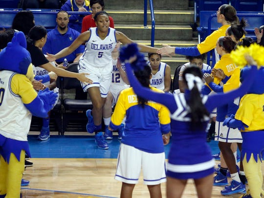 Delaware forward Makeda Nicholas takes the floor during introductions before the Hens beat Towson, 72-54, at the Bob Carpenter Center Thursday.