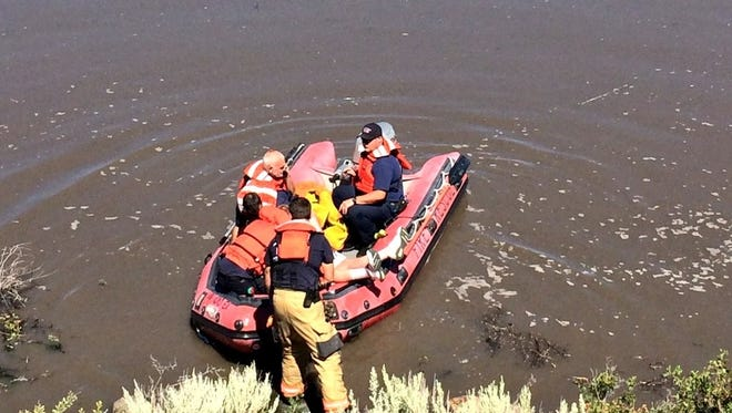 Rescue crews with the Truckee Meadows Fire Protection District pulled two men out of the water after they crashed their pickup truck at Washoe Lake on Aug. 13, 2017.