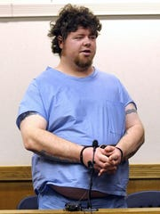 Timothy Fradeneck stands during his arraignment, Wednesday afternoon, April 15, 2015, in Eastpointe, Mich. Fradeneck, 38, was charged with first-degree murder in the deaths of his wife and children, whose bodies were found in their Eastpointe home.