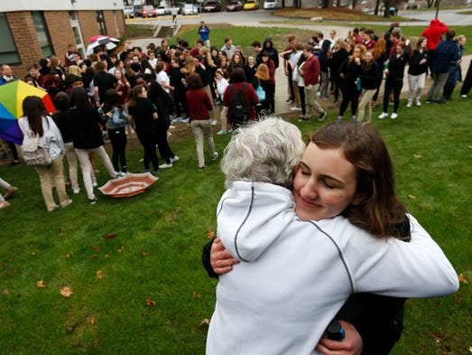 Dowling sophomore Grace Mumm, 16, gets a hug from grandmother