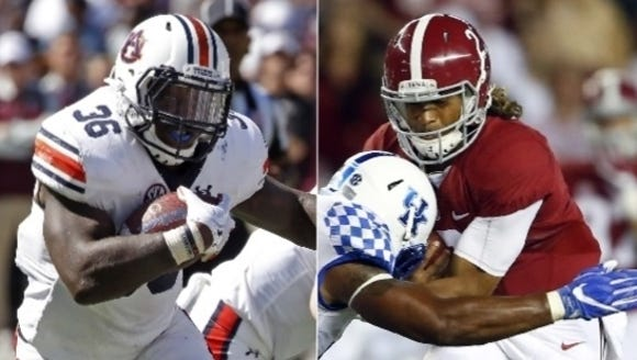 Auburn running back Kamryn Pettway and Alabama quarterback