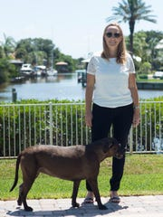 "Entrepreneur and IT consultant Emily Mollen, seen May 9, 2018 with Abby, one of her two dogs, lives in a spacious Indian Harbour Beach home with her fiance and dogs, a perk of relocating to Brevard County from the expensive, high-tech area of Silicon Valley in California. ""I had friends working for Google and Facebook making $200,000 to $300,000 a year and they had to share an apartment with a stranger,"" Mollen said, noting that following her own move to Florida, two of her friends also have relocated to Brevard County to take jobs with SpaceX and Lockheed Martin."