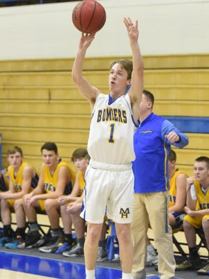 Mountain Home's Wyatt Gilbert shoots a 3-pointer during the Junior Bombers' 44-34 victory over Bergman on Monday night.