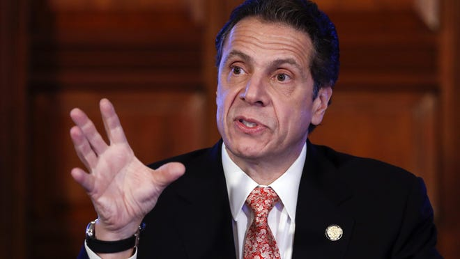 New York Gov. Andrew Cuomo talks during a cabinet meeting at the Capitol.