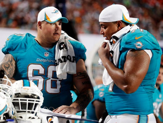 Dophins_Scandal_Football_NY163_WEB825602