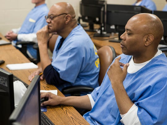 San Quentin inmate Nelson Butler, right, takes a coding class at San Quentin State Prison in San Quentin, Calif.