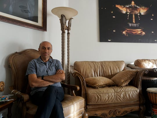 Kaveh Shahidi, 51, fled through the mountains of Kurdistan.